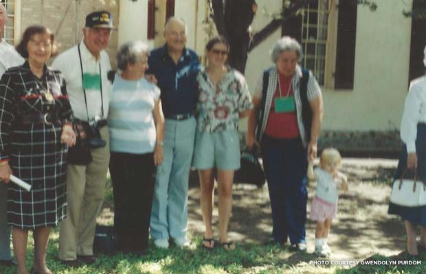The author, age 2 (second from right), with relatives in front of 212 E. Zink St. in New Braunfels, the house her ancestors bought in 1883. Credit: Gwendolyn Purdom