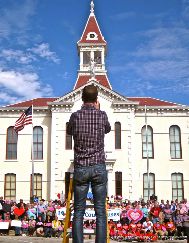 Jason Clement takes pictures at Wilson County Courthouse during the I Love Texas Courthouse campaign. Credit: National Trust for Historic Preservation