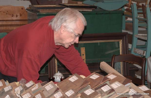 Hotel historian Bill Defibaugh pores over old guest ledgers in the hotel's archives. Photo courtesy Mary Dorner