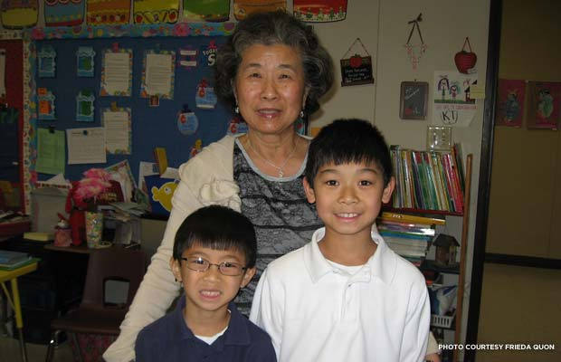 Frieda Quon, who grew up in her parents' grocery store in Greenville, Miss., poses with her grandchildren. Credit: Frieda Quon