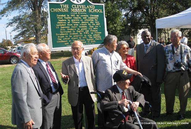 A group of former students at the Cleveland Chinese Mission School gathers at the plaque dedication. From left: Fee Joe, Ed Joe, Kellogg Wong, Fun Pang, J.W. Dunn (seated), Annette Joe, Vice Mayor Ted Campbell, and Bobby Moon. Credit: Gilroy and Sally Chow