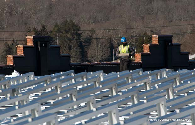 Solar panel installation at Mystic Seaport Collections Research Center. The brick parapet is visible in the background. Credit: Mystic Seaport