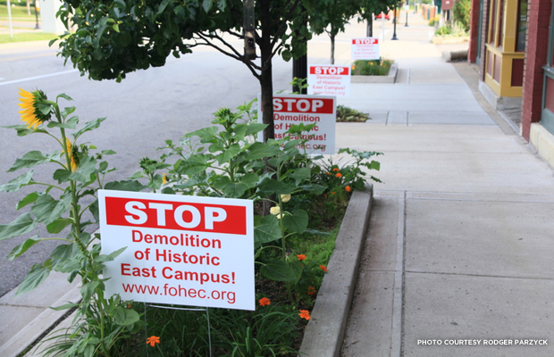 Some of the many signs inside Kalamazoo and the University's grounds that show the disagreement between the public and the University's choice to demolish East Campus. Credit: Rodger Parzyck.