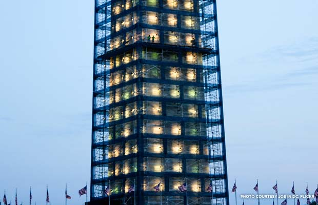 Construction workers stand in the lighted scaffolding of the Washington Monument. Credit: Joe in DC, Flickr