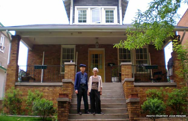 Joan's father and mother pose on the historic home's steps in 2013. Credit: Joan Menzer
