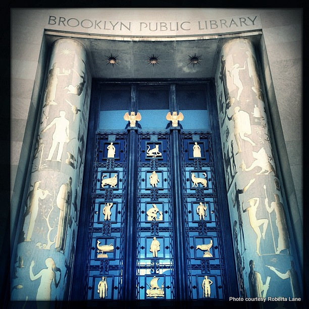 The newly restored doors at Brooklyn Public Library. The Brooklyn Public Library was designed to look like an open book. Credit: Roberta Lane