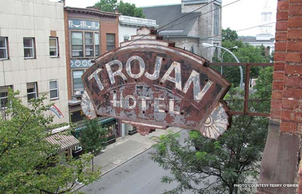 Though the original sign was destroyed in a fire in the late 19th century, the sign on the exterior of the building today is more than 100 years old. Credit: Terry O'Brien
