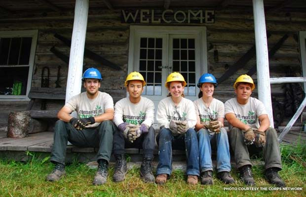 From left to right: Conservation Corps Minnesota and Iowa members Nick Cox, Nai Yang, Christina Schaufler, Emily Miller, and Isac Kautto in front of the West Bay Lodge. Credit: The Corps Network