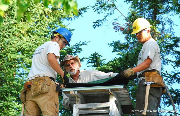 Minnesota and Iowa Conservation Corps members Nick Cox and Isac Kautto work on the icehouse cupola under the supervision of Mike Polencheck. Credit: The Corps Network