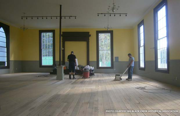 Workers sand the yellow poplar floors of the church where Civil War soldiers walked 150 years ago. Credit: Big Black Creek Historical Association