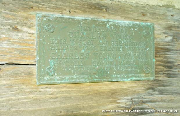 A plaque informs visitors of the cabin's significance. Credit: Bill Macintire, Kentucky Heritage Council