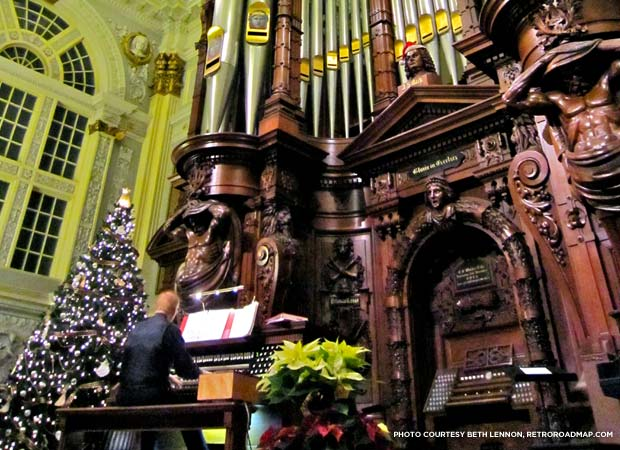 Organist playing the Methuen Music Hall Grand Organ at Christmas. Credit: Beth Lennon, RetroRoadmap.org