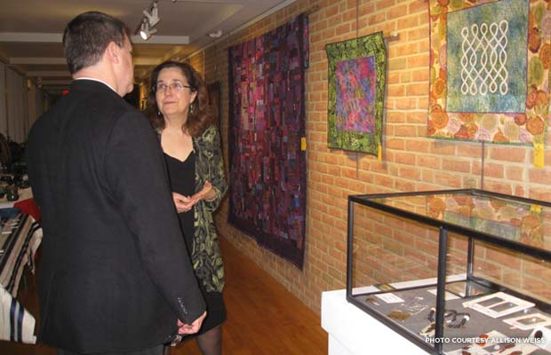 Lauren Kingsland and Steve Bellairs at fine arts and crafts holiday show. Credit: Allison Weiss