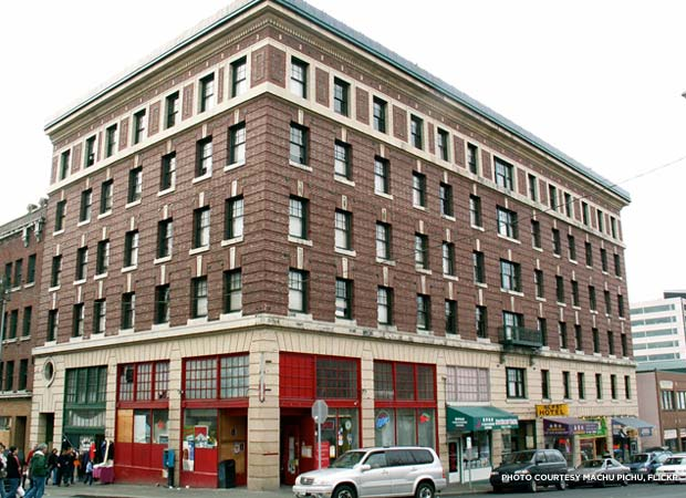 The Alps Hotel in Seattle, Wash. This building has more units of housing and more storefronts than the majority of block-sized bread-loaf projects in Seattle. Credit: Machu Pichu, Flickr