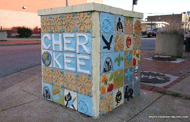 Cherokee St. has beautiful buildings, but it also knows how to have fun with street art. STL and community landmarks adorn the tiles. Credit: beltstl.com