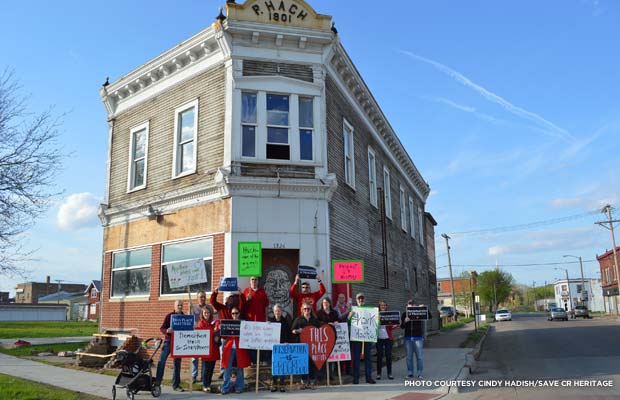Members of Save Cedar Rapids Heritage gather to protest the demolition of the Hach Building before the owner razed the building, considered a contributing structure in the New Bohemia Historic District. Credit: Cindy Hadish/Save CR Heritage