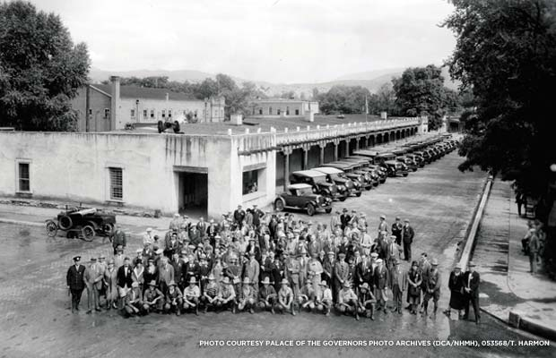 Indian Detours personnel group photo with Harvey cars lined up in front of Palace, c. 1926 - 1930.