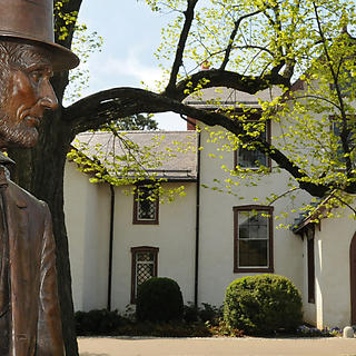 Statue of Lincoln with cottage beyond