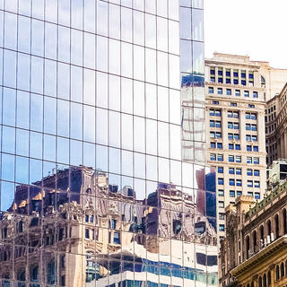 New building reflecting old buildings