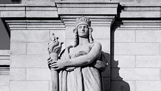 One of six allegorical statues on the façade by sculptor Louis St. Gaudens.