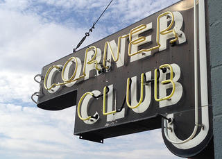 The Corner Club sign during the day