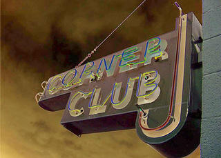 The Corner Club sign at night