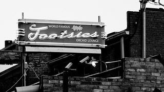 Tootsies World Famous Orchid Lounge back door sign