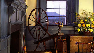 Interior of Belle Grove with a spinning wheel