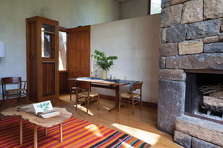 Interior of the Fisher-Kahn House with simple wood furniture