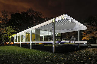 Exterior of the Farnsworth House with white lights