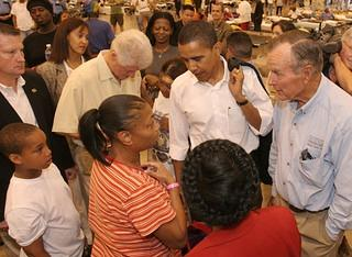 Former presidents Clinton and H. W. Bush, and Senator Obama,  visits hurricane refugees at the Astrodome.