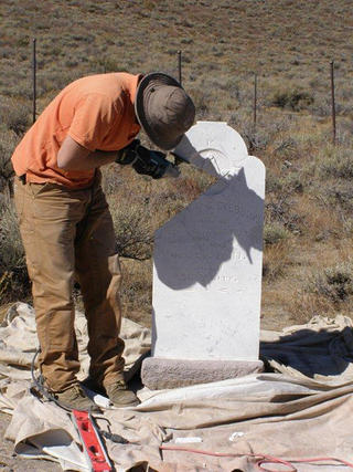 Worker stabilizes headstones in Bodie, California