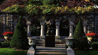Garden pergola with sculpture