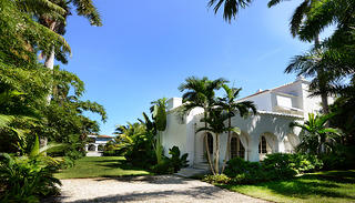 The property includes a gatehouse, main villa, and two-story cabana