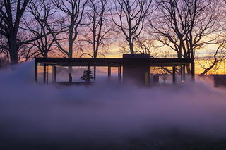 The Glass House surrounded by fog