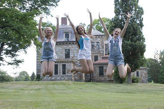Kayleigh Travins, Maggie Shoemaker, and Bridget Brady celebrate at the Burnett/Garfield House