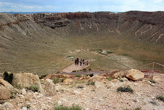 People visiting crater site