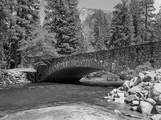North side of Sugar Pine Bridge. Half Dome is viewed through the trees at left rear.