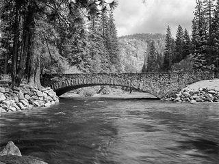 Sugar Pine Bridge across the Merced River view looking up river.