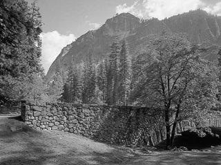 Northwest corner of Sugar Pine Bridge. Glacier Point is seen in the background.