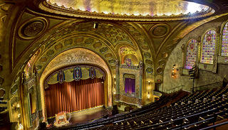 Interior image of the seating and stage at the Alabama Theatre
