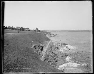 Two women walk along Newport's Cliff Walk in 1880