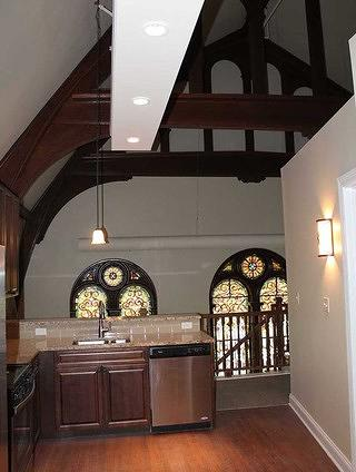 Lafeyette Lofts interior featuring original stained-glass windows