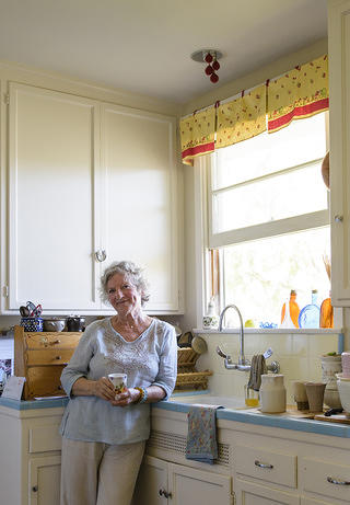 Ingrid Mueller in her restored Lincoln Place kitchen