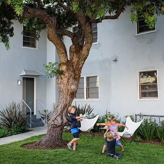 Young residents play in a courtyard at Lincoln Place