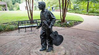 Statue of a thirteen-year-old Elvis Presley at the Elvis Presley Birthplace in Tupelo, Mississippi