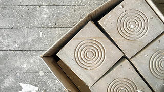 Bullseye rosette molds for the door frames sit in a box.