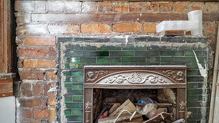 The interior fireplace continues to be restored.