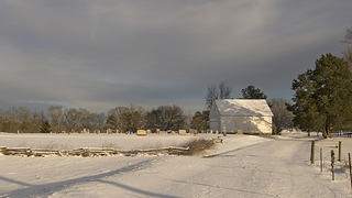 Wide side view of Shiloh Methodist Church and cemetery in snow