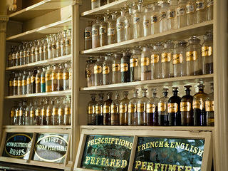Vials line the shelves of the apothecary